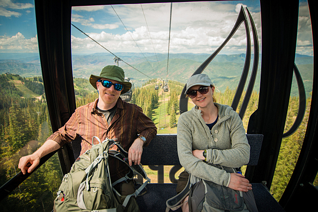 Host Fred Child and producer Suzanne Schaffer ride the gondola to the concert on Aspen Mountain