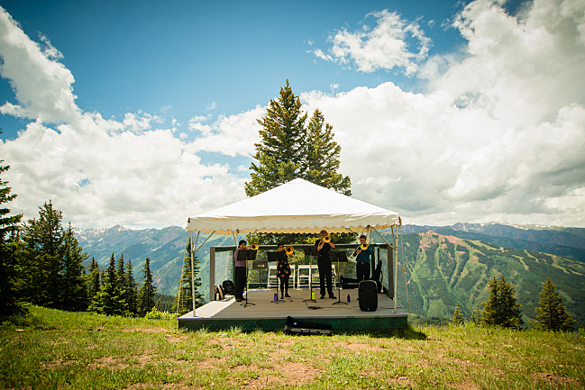 Trombonists perform on the top of Aspen Mountain