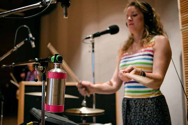 Percussionist Dani Markham bangs on a water bottle with tUnE-yArDs live in The Current studio.