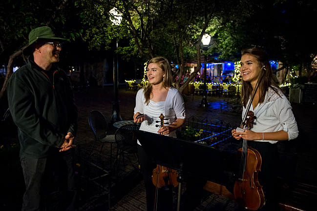 Fred Child with buskers; violists Bethany Hargreaves and Chloe Thominet