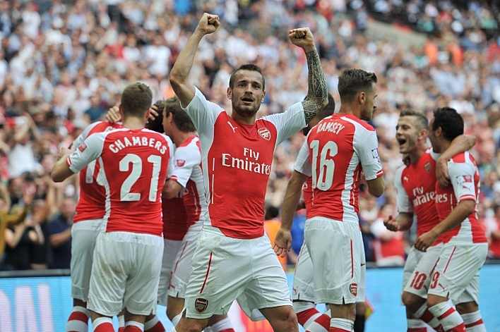 An impressive Arsenal brushed Manchester City FC aside 3-0 to win the Community Shield at Wembley. Goals from Santi Cazorla, Aaron Ramsey and Olivier Giroud La Page Officielle saw the Gunners run out comfortable winners to claim their second trophy in three months.