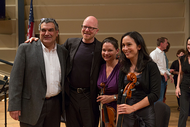 Composer Ofer Ben-Amots, PT host Fred Child, violinist Karen Kinzie, and cellist Amy Leung pose for pictures following the performance.