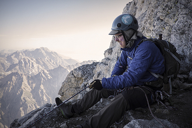 Fred belays his climbing partner high up on the Grand Teton, ready to catch them if they slip.