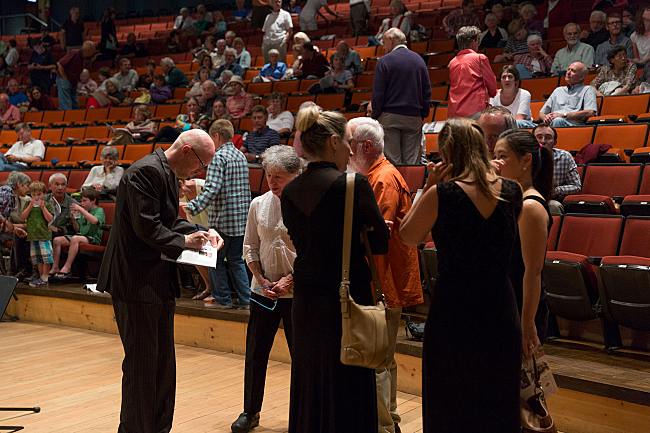 PT host Fred Child autographs programs during intermission at the Grand Teton Music Festival.