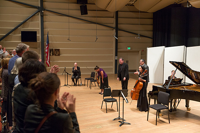 Violinist Karen Kinzie, pianist Scott Holshouser, and cellist Amy Leung take a bow after their performance of Ofer Ben-Amots' Odessa Trio at Walk Festival Hall at the Grand Teton Music Festival.