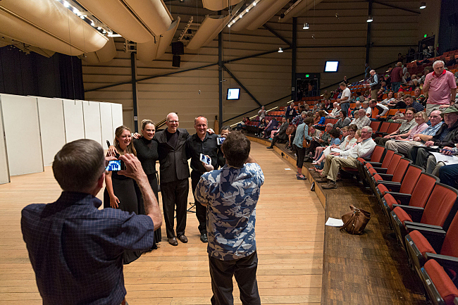 Oboist Elizabeth Koch Tiscione, cellist Charae Krueger, Fred Child, violinist Jay Christy and violist Yang-Yoon Kim (obscured) pose for fans following the show.