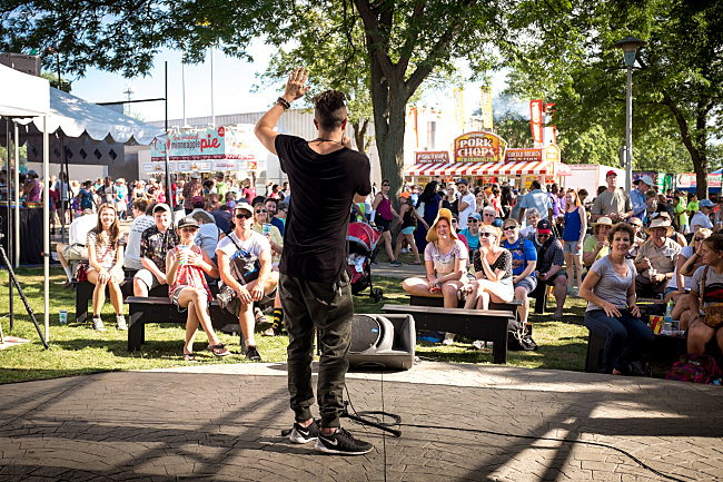 Sims performs before the Minnesota State Fair crowd at the MPR booth.