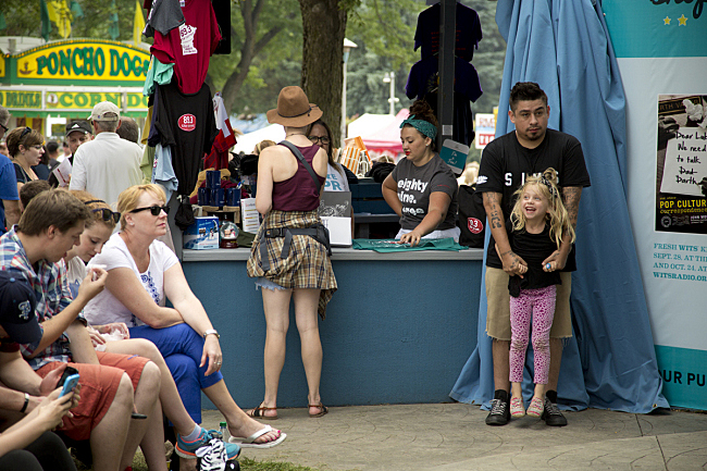 Mike Mictlan and his daughter hang out at the MPR booth at the Minnesota State Fair.