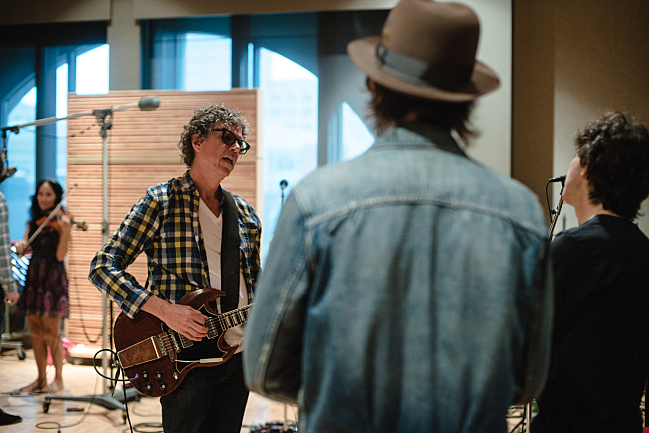 Violinist Jessey Green warms up as the Jayhawks' Gary Louris, Jon Jackson and Marc Perlman chat in The Current studio.