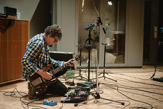 Gary Louris tunes his guitar before performing live in The Current studio with the Jayhawks.