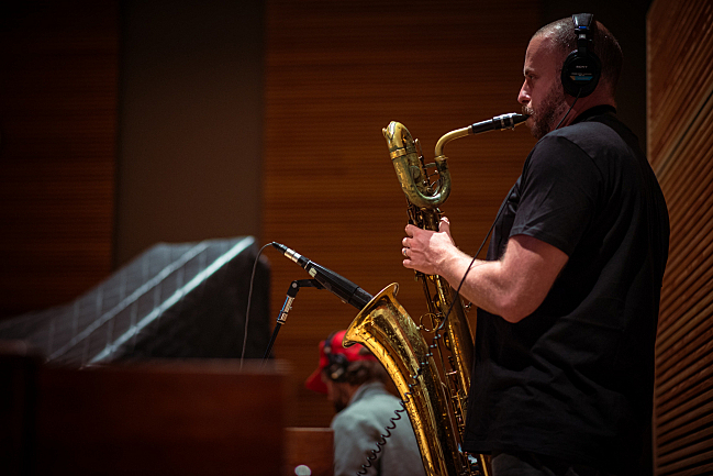 John Natchez plays saxophone with the War on Drugs in The Current studio.