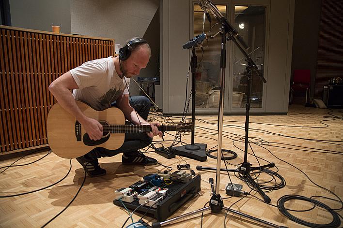 Nils Edenloff of the Rural Alberta Advantage soundchecking in The Current studio.
