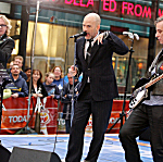 R.E.M. (L-R: Mike Mills, Michael Stipe and Peter Buck) perform during the NBC 'Today' show concert series at Rockefeller Center on April 1, 2008, in New York City.