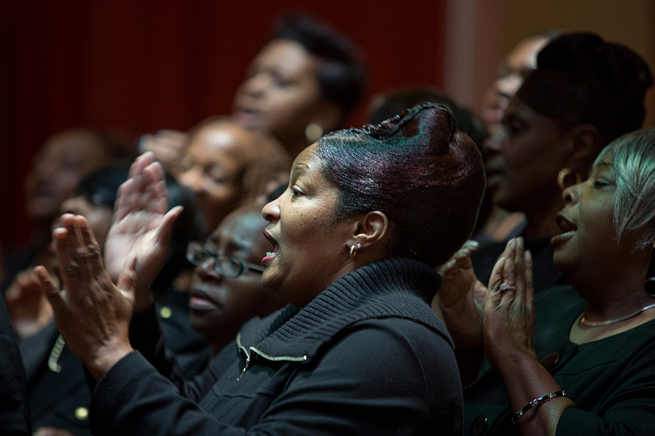 The choir from Greater Mount Vernon Baptist Church sings before the inauguration of Minnesota's constitutional officers at the Landmark Center Monday, Jan. 5, 2014 in St. Paul.