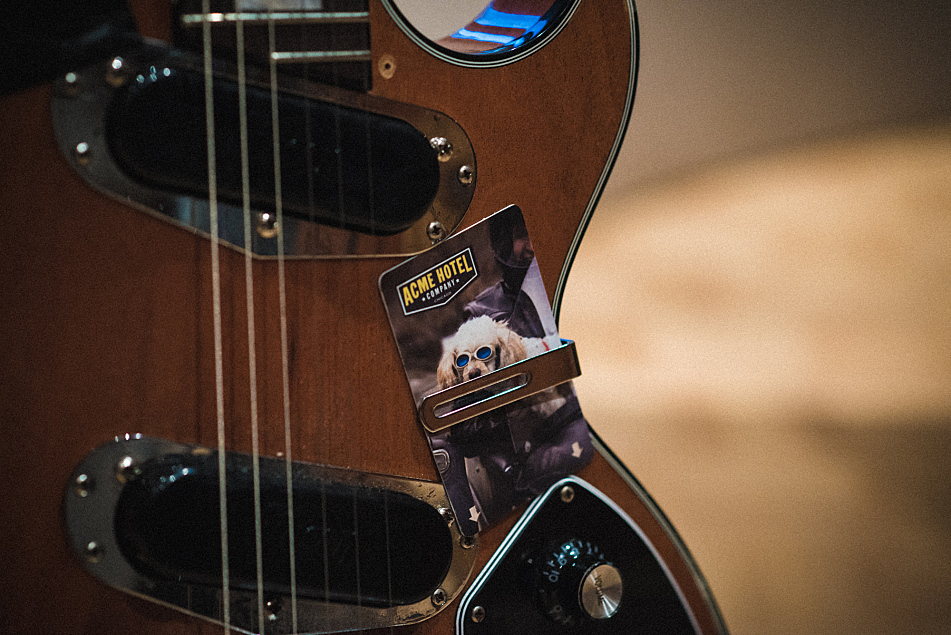 A key card from the Acme Hotel in Chicago decorates the Districts' Gibson Les Paul Recording II.
