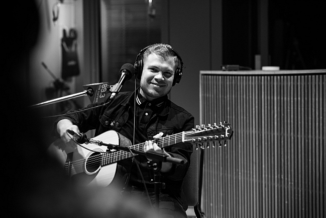 Connor Doyle with a 12-string guitar performing live with BORNS in The Current studio