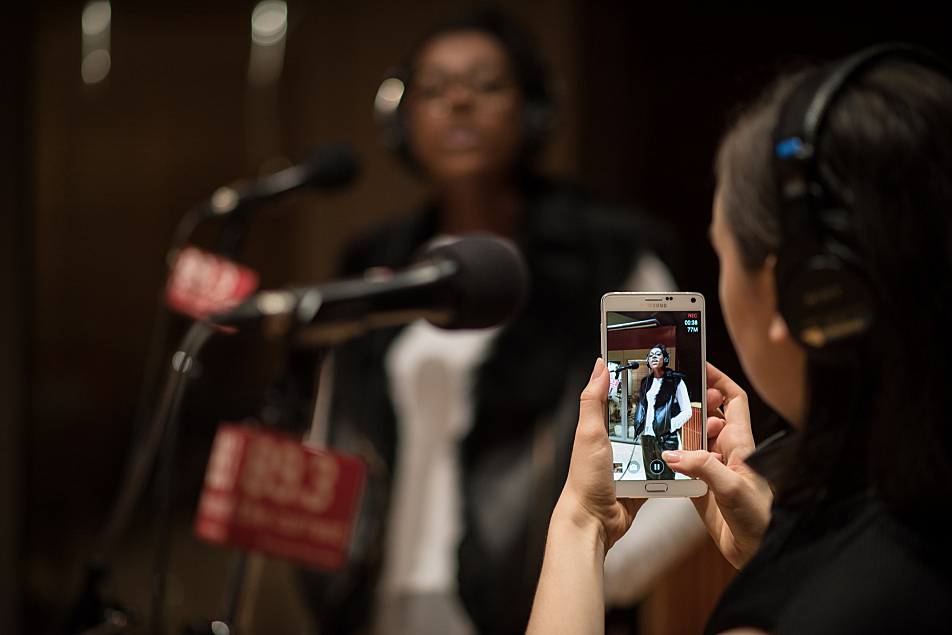 Meg Mac takes a photo of vocalist Anais as they prepare to perform in The Current studio.