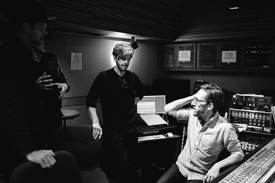 Members of Albert Hammond Jr.'s band confer with MPR engineer Corey Schreppel in the control room in The Current studio.