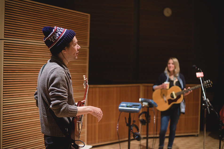"""Stephen """"The Kid"""" Howard (L) accompanies Lissie on guitar in The Current's studio."""