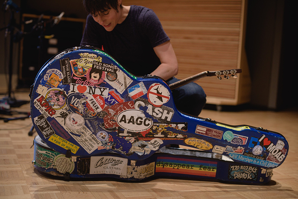 Ellis's guitar case tells the story of a road heavily traveled.