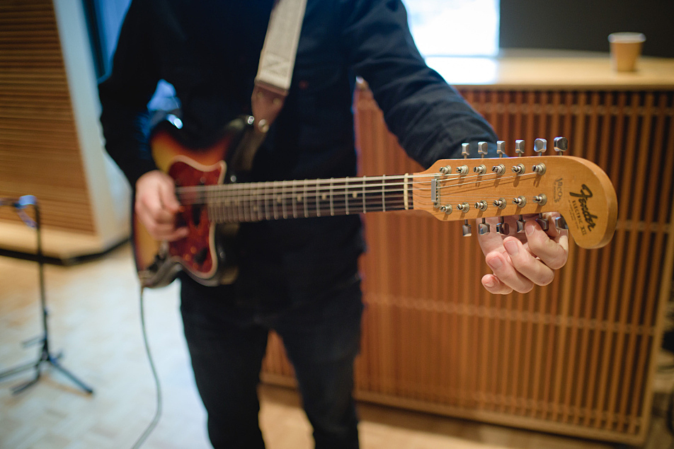 Doug Keith tunes his guitar before performing with Martin Courtney in The Current's studio.