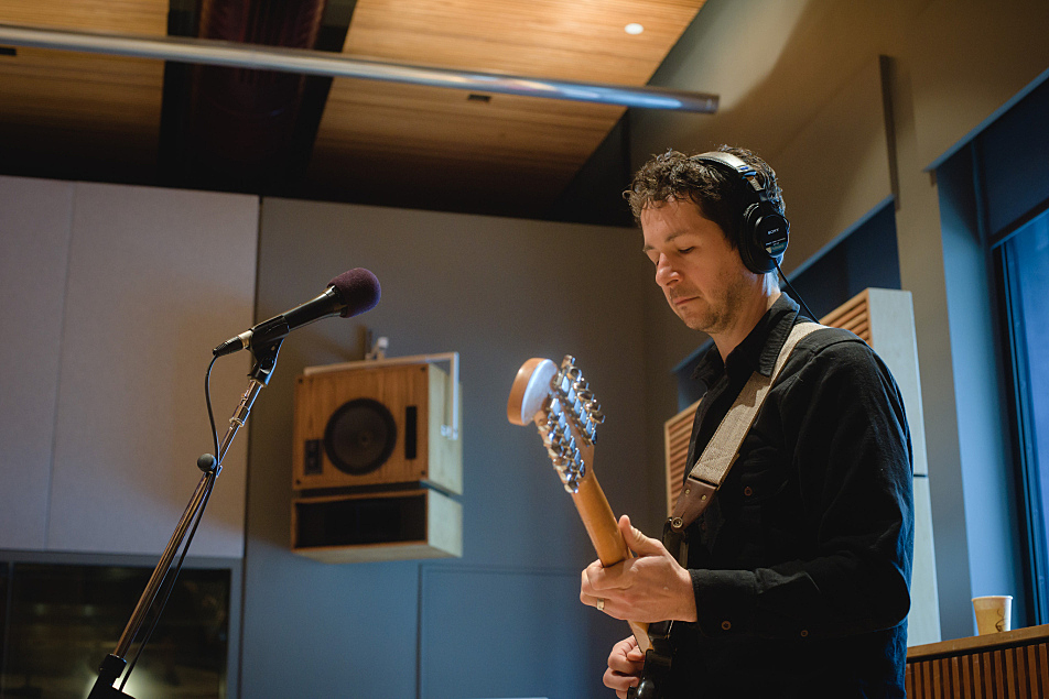 Doug Keith plays lead guitar with Martin Courtney in The Current's studio.