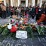 People gather to leave tributes at the Place de la Bourse following today's attacks on March 22, 2016, in Brussels, Belgium. At least 31 people are thought to have been killed after Brussels airport and a Metro station were targeted by explosions.