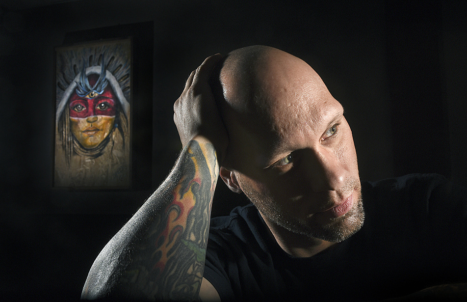 """The money is just a number. What I really want is my life back,"" says 38-year-old Michael Hansen at his tattoo shop, Kinship Collective Tattoo, in Northfield. Hansen is one of the first people under a new Minnesota exoneration law to qualify for financial compensation for time spent locked up."