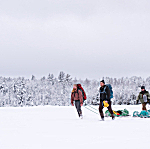 """Left to right: guide Levi Lexvold, musician Ben Weaver, The Current's Bill DeVille and adventurer/educator Dave Freeman hike across a frozen lake in the Boundary Waters Canoe Area. DeVille later called the trip, """"an adventure of a lifetime."""""""