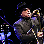 Van Morrison performs on the stage of the Olympia concert hall in Paris, on Sept. 14, 2012